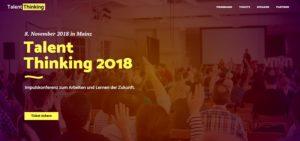 """gelbe Schrift """"Talent thinking 2018"""" vor transparentem Bild"""